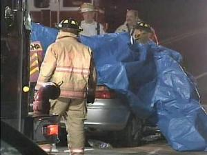 A blue tarp covers a vehicle involved in a Tuesday evening crash on Buffaloe Road and Westminster Drive.