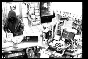 Surveillance photos from Goldsboro Police show the suspect in a series of armed robberies.