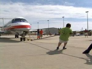 Teams competed to see who could pull a 40,000 pound jet the fastest.