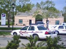 Durham County deputies investigate a robbery at a First Citizens Bank branch on April 25, 2008.