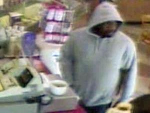 A surveillance camera filmed a man  robbing a Dunkin' Donuts store, 6613 Falls of Neuse Road, at gunpoint around 12:30 p.m. on Friday, April 11.