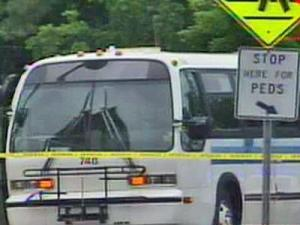Police tape surrounds the intersection where a bus hit an unidentified pedestrian on Thursday, May 15, 2008.