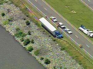 A tractor-trailer ran off the right side of U.S. Highway 64 East and struck a guardrail on a causeway across Jordan Lake near Pittsboro on Monday, May 19, 2008.