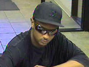 A security camera captured an image of a man suspected of robbing a Bank of America branch in Fayetteville on June 10, 2008.