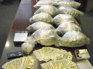 Marijuana and money seized from a Holly Springs home on July 2, 2008.