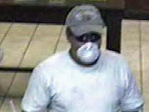 Cary police on Monday, July 7, 2008, released this surveillance-camera photo of a man wanted in the July 3 robbery of a First Citizens bank branch.
