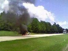 Smoke billows from a 1984 Monte Carlo that caught fire along Interstate 40 East near exit 312 to N.C. Highway 42 in Johnston County on Sunday, July 20, 2008.