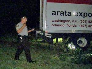 A police officer walks around the stolen truck.