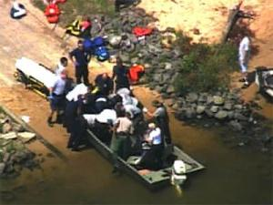 Paramedics try to revive a man found floating in Falls Lake on Aug. 1, 2008.
