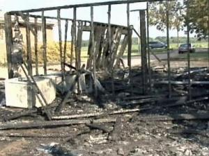 The remnants of a barn that caught fire near Kenly on Aug. 8, 2008.