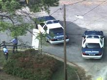 Officers investigate a shooting iin the parking lot of a Crown gas station at Saunders and Granite streets around 4:40 p.m. on Friday, Aug. 22, 2008, police said.