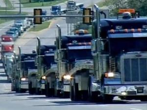The World's Largest Truck Convoy rolls through Des Moines, Iowa, in September 2007 as part of a nationwide fundraiser for Special Olympics.