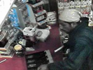 A surveillance image from the armed robbery of the White Oak Mart in Garner on Sept. 25, 2008. (Image from the Wake County Sheriff's Office)