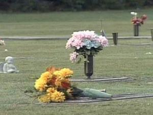Flowers were knocked over after gravesites were ransacked at the Riverview Memorial Gardens cemetery in Benson overnight on Sept. 26, 2008.