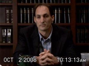 Brad Cooper gives a deposition on Oct. 2, 2008, in this video image still made public Oct. 9, 2008.