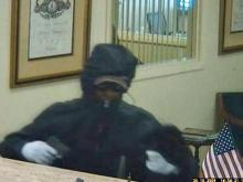 Surveillance cameras caught a man armed with a handgun who robbed the First Citizens Bank, 126 Broadfoot Ave. in Fayetteville, on Thursday, Oct. 30, 2008.