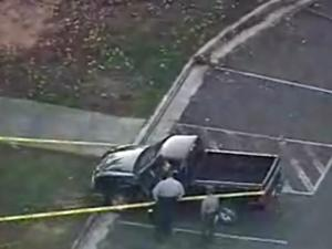 Deputies look at a black pickup truck in a parking lot at the Beaver Dam entrance to Falls Lake State Park, 15000 Creedmoor Road, as they investigate a shooting on Monday, Nov. 10, 2008.