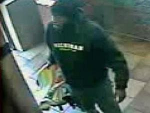 Officers released this photo Thursday of the unidentified man taking a baby into a McDonald's restaurant in southwest Charlotte.