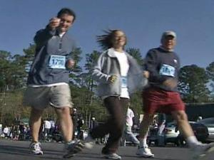Participants in the capital city's annual Ridgewood Turkey Trot fun run stride their stuff Thursday, Nov. 27, 2008, in brisk air under blue skies.