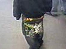 The back of the robber's jeans had a large bird design and other unknown embellishments.