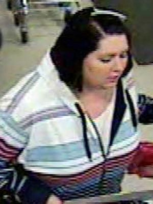 A surveillance image of one of three suspects accused of using a stolen financial card on Jan. 7, 2009. (Image from the Raleigh Police Department)