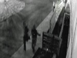 A surveillance camera caught three people running away from the 2400 block of Poole Road after Andrew Willie Brown, 47, was shot there Monday, Feb. 9, 2009. He later died of his wounds at WakeMed.