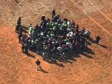 Workers from CaptiveAire in Youngsville evacuated to a field after their building caught fire March 6, 2009.