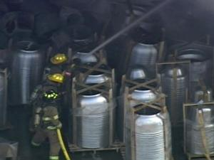 Firefighters work at CaptiveAire in Youngsville