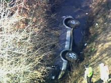 A vehicle came to rest on its side in a ditch after a collision in Sampson County Monday.