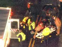 EMS workers treat a person after a pedestrian wreck at 10410 Penny Road in Cary early Friday, March 13, 2009.