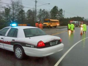 Cary Police closed Penny Road, near Kildaire Farm Road, after a car struck a 12-year-old boy and his parents while they were waiting for a school bus early Friday, March 13, 2009.