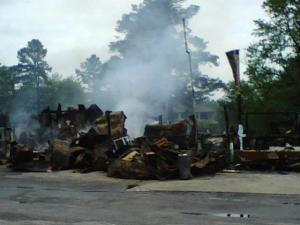Crews from five departments fought a fire at Walt's Food Mart and Auto Sales off Pearces Road near the Wake County line Wednesday morning.