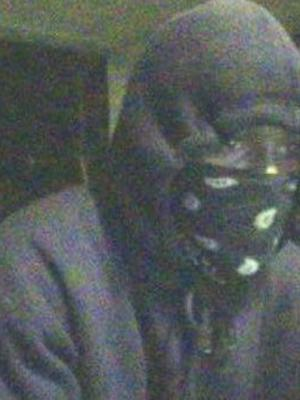 Surveillance video of a suspect in an armed robbery at an ATM of the Bank of America, 4811 Hope Valley Road in Durham.