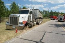 A tractor-trailer sits idle after a wreck in Moore County Tuesday.