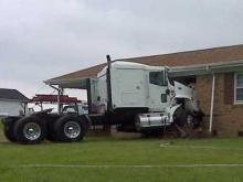 Tractor hits house, man mowing lawn