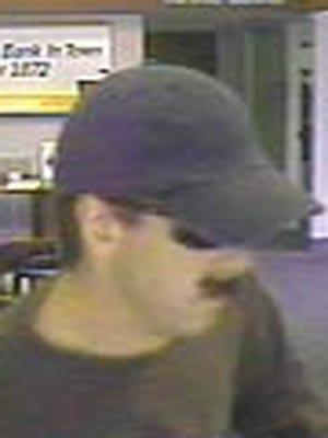 A surveillance photo of the suspect in the robbery of the BB&T Bank at 7447 Six Forks Road in Raleigh on July 8, 2009.