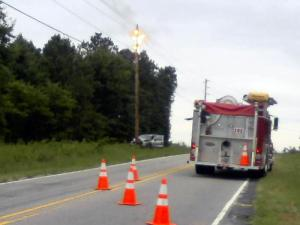 An SUV slammed into a utility pole at the intersection of Louisburg and Forestville roads, sparking an electrical fire.