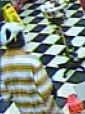 A surveillance image of one of the suspects in the break-in of the Quality Food Mart at 2007 Presidential Drive in Durham.