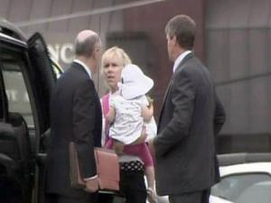 Rielle Hunter, John Edwards' former mistress, arrives with her daughter at the federal courthouse in Raleigh, where a grand jury is meeting.