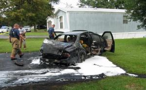 Selma police said that Latonia Tamika Monroe-Myers, 38, of 115 Lincoln St., set fire to and destroyed her 1995 Nissan Maxima in her driveway as two men were trying to repossess it Wednesday, Sept. 3, 2009. (Photo courtesy of Selma Police Department)