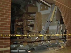 A vehicle crashed into a storage facility at 5910 Duraleigh Road around 10:15 p.m. Monday, Sept. 7, 2009. Raleigh police are searching for the driver.