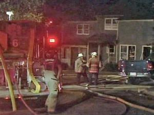 An early morning fire destroyed two townhouses on Old Maple Lane, in the Heritage Woods subdivision in southern Durham, on Monday, Sept. 14, 2009.