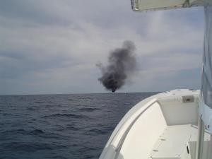 A witness captured this photo of a boat on fire Sunday in the Atlantic Ocean about 35 miles north of Beaufort Inlet.