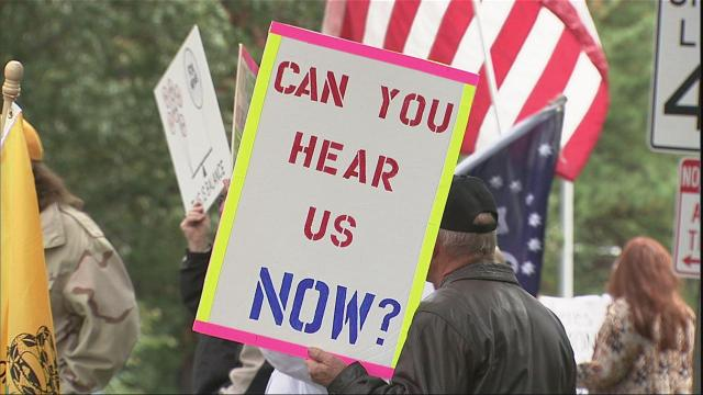 About 60 people rallied outside WRAL studios in Raleigh Saturday.