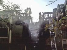 Two plucked from burning apartment building
