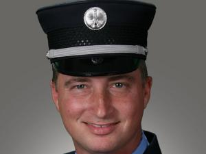 "Lt. Harry P. ""Flip"" Kissinger IV, with the Raleigh Fire Department, was injured in a three vehicle wreck, including a Wake County school bus, on Ligon Mill Road, near Louisburg Road, early Friday, Dec. 4, 2009. (Photo courtesy of the Raleigh Fire Department)"
