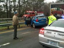 State troopers were on the scene of a single-car wreck that closed lanes of Interstate 85 Friday.