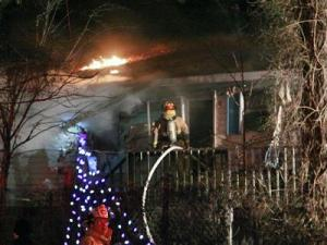 Holly Springs firefighters battle a house fire at 221 W. Ballentine St. on Friday, Jan. 8, 2010. Holly Springs EMS and the Apex Fire Department also responded. (Photo by Thomas L. Babb)