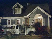 Pickup hits house; driver seriously injured