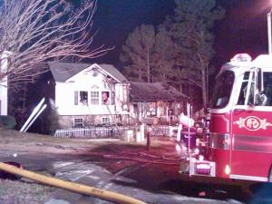 Firefighters respond to a house fire at 7300 Fox Bluff Court in Raleigh on Saturday, Jan. 23, 2010.